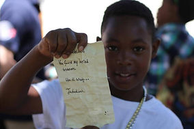 Boy shows off note found during treasure hunt