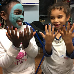 Happy little girls showing off freshly-painted nails