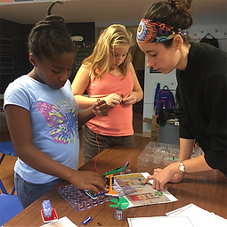 CAN students and instructor doing crafts