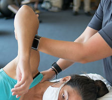 a female client receiving a shoulder assessment from a massage and bodywork therapist