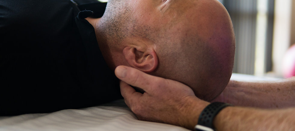 craniosacral therapist performing craniosacral therapy on a client