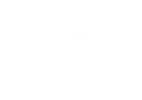 Fruit2Work logo overlaying a photo of a Fruit2Work employee packing fruit boxes