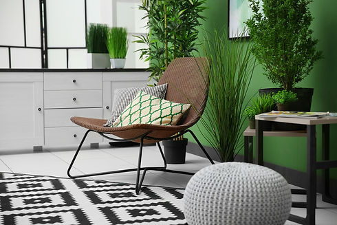 Cozy armchair in modern green interior.j