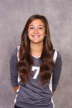 "Volleyball senior thrives as team ""mom"""
