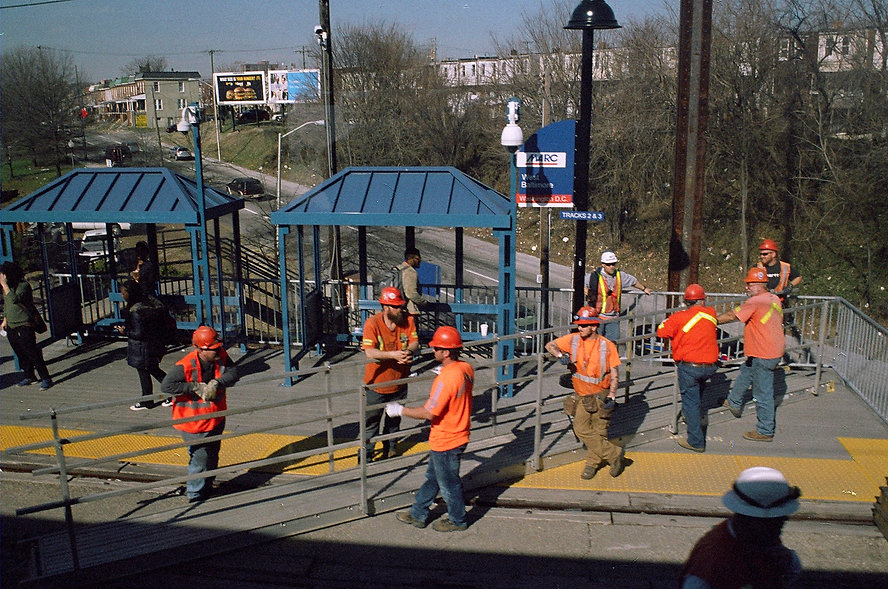 Yuqing Zhu film photography.  Construction workers at West Baltimore station.