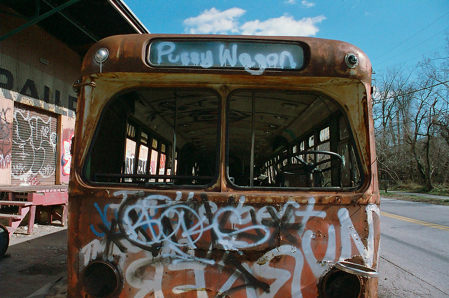 Yuqing Zhu film photography. Abandoned bus behind the Streetcar Museum in Baltimore.
