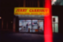 Yuqing Zhu film photography. Jerry Carryout at night, in Station North, Baltimore.