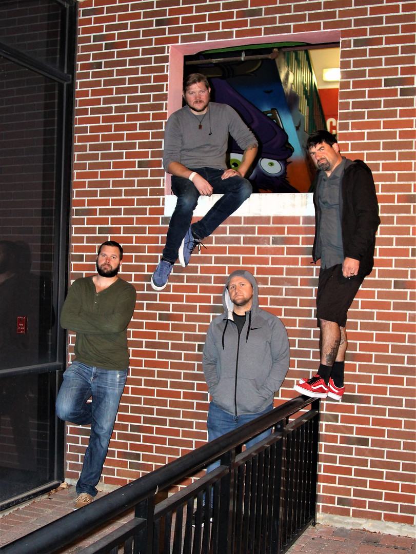 better band pic on wall.jpg