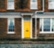 yellow-door-on-brick-home.jpg