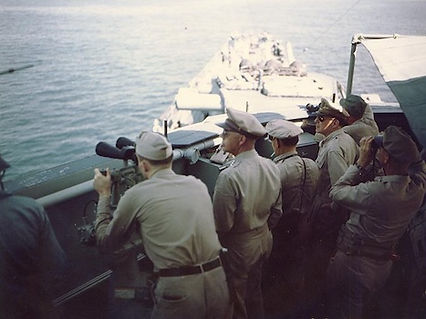 MacArthur on board USS Nashville.jpg