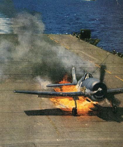 Hellcat flies in on fire.jpg