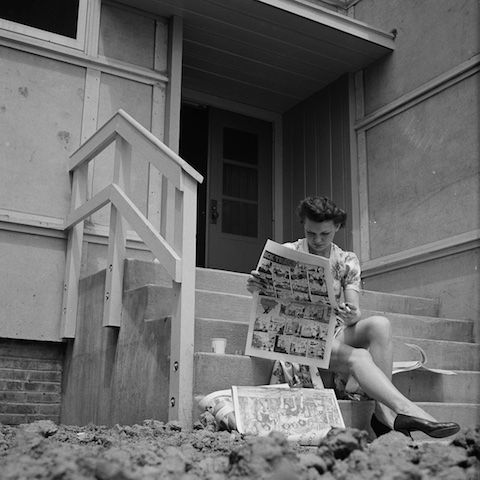 Reading paper outside Idaho Hall, Girl T