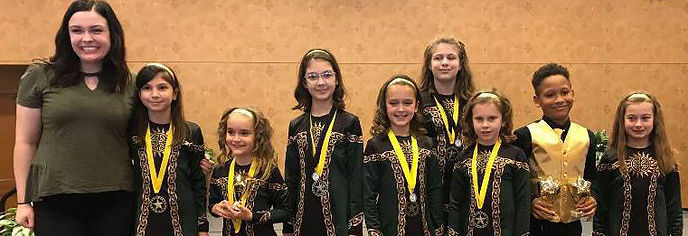 Irish Dance team with trophies and medals
