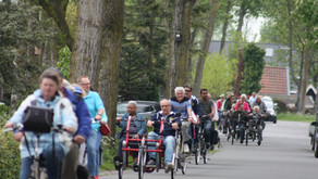 Lions fietsen met visueel gehandicapten