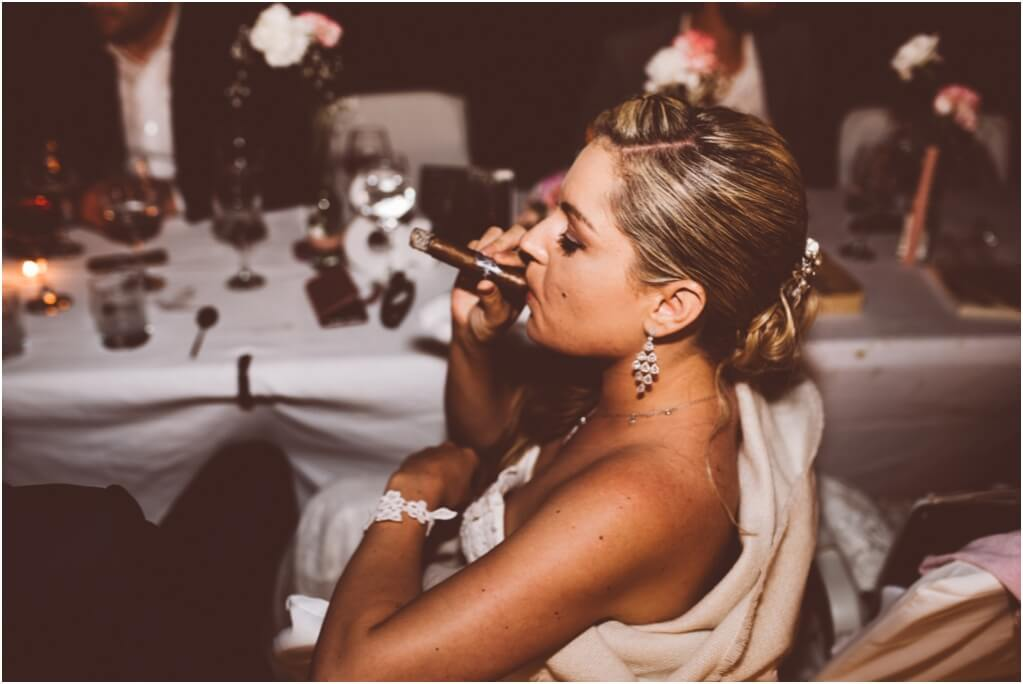 bride-smoking-cigars-at-dana-villas-sant