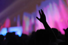 christian-music-concert-with-raised-hand