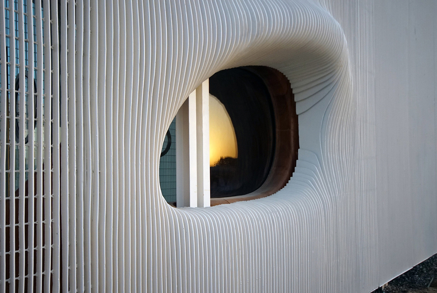 Detail view of Oculus window at sunset