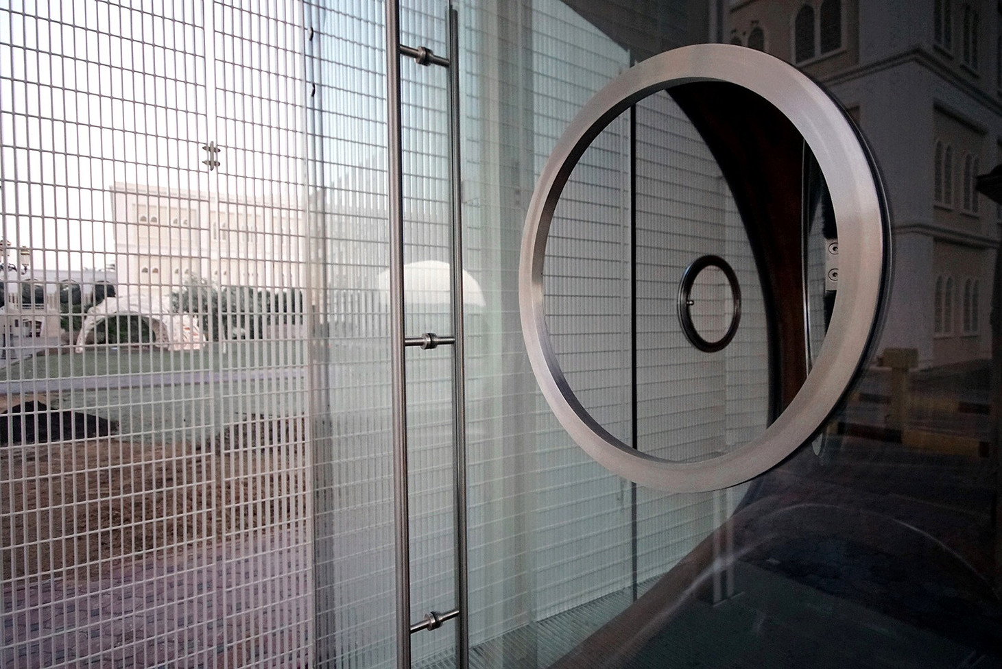 View of Security Booth air conditioned space through entry door and porthole window