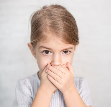 portrait of little girl, child closing his mouth with hands. Speech therapist, speech prob
