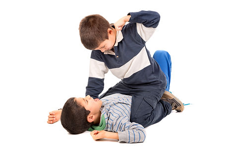 Young boys fighting isolated in white.jpg