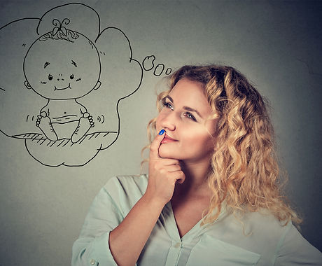 Content young woman is taken with idea of having child while posing on gray. .jpg