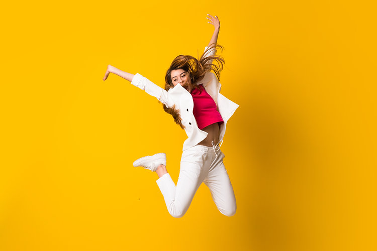 young-woman-jumping-over-isolated-yellow