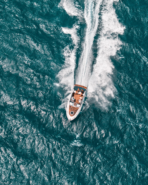 aerial-high-angle-view-of-a-speedboat-riding-the-waves.jpg