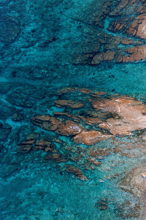 high-angle-aerial-view-of-rocks-and-underwater-sea-structure.jpg
