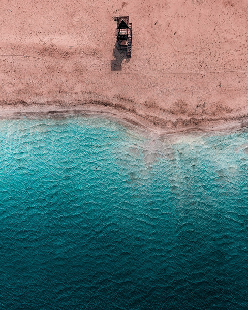 aerial-view-of-lifeguard-tower-by-the-coastline-of-turquoise-aegean-sea.jpg