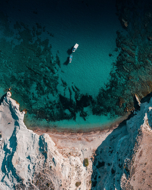 high-angle-aerial-view-of-a-boat-and-crystal-clear-sea.jpg