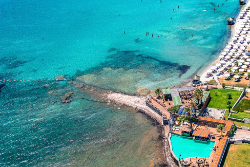 aerial-view-of-people-swimming-in-turquoise-sea-and-a-beach-club.jpg