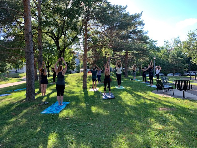 A yoga class taking place in Mueller Park in Minneapolis.