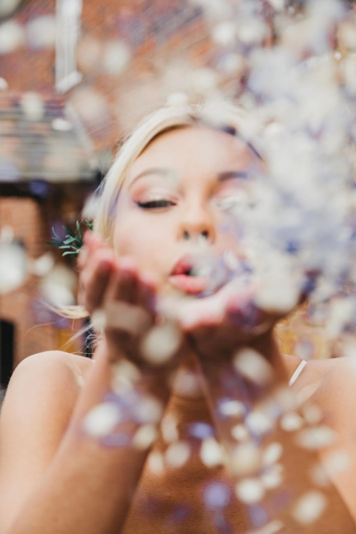 molly blowing confetti.jpeg