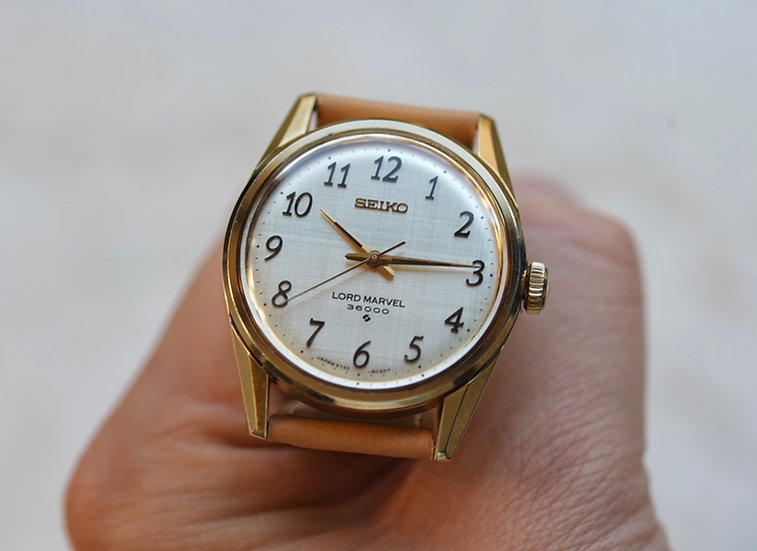 Lord Marvel 36000 gold plated case with Arabic numeral linen dial