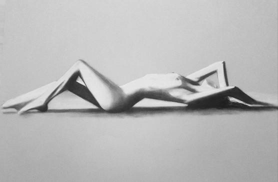Nude woman laying down