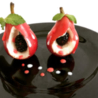 Fruits Dessert. Pears with blackberries,