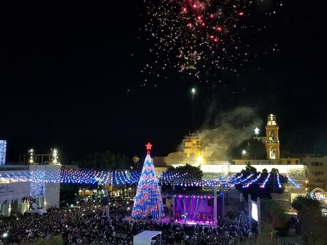 Christians celebrate the lighting of  Christmas tree in Bethlehem