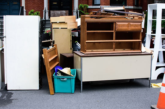 Items and old furniture on street outsid