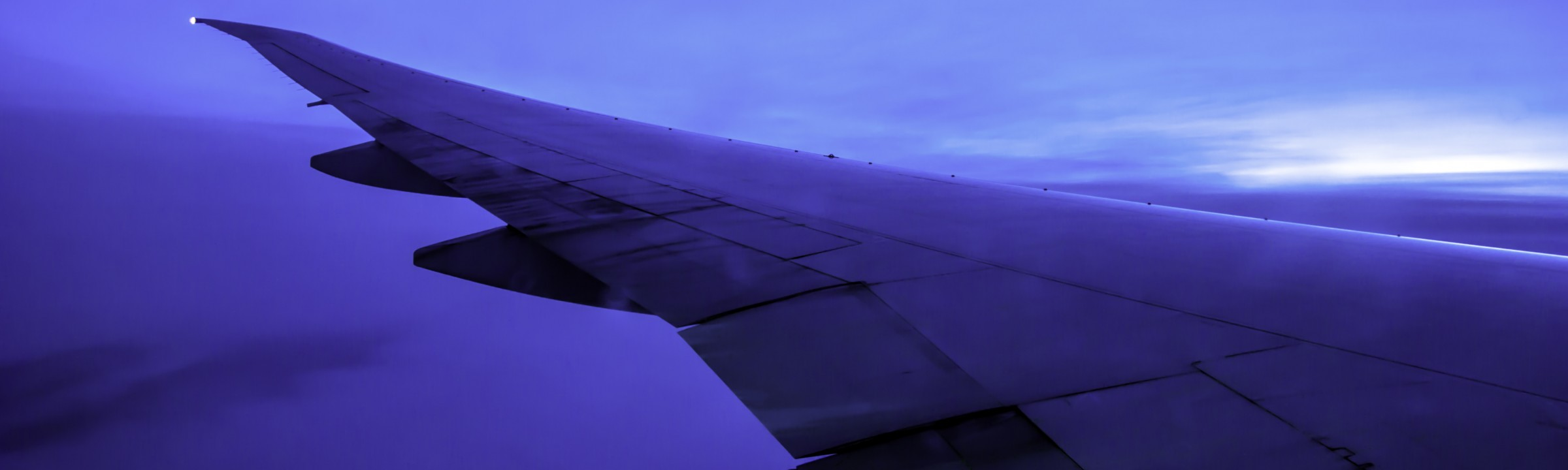 cropped-header-airplane-wing