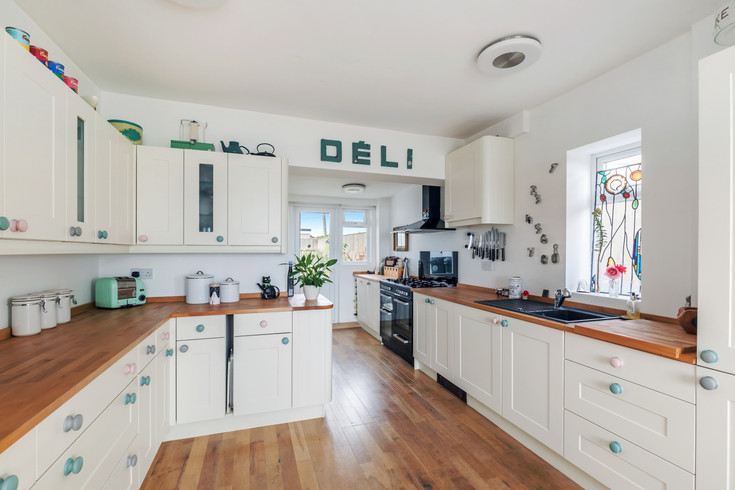 Rustle up a snack in the stunning kitchen diner with sea views
