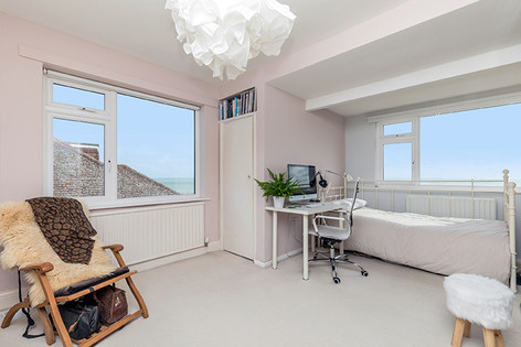 Large bedroom (two of five) with dual-aspect sea views