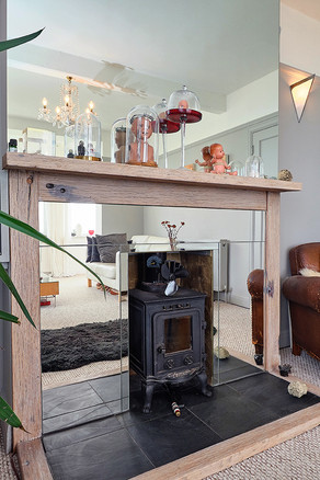 Well, lookie here at the divine multi-fuel stove with full-length mirror surround