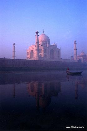 A Lone Boatman Drifts Past the Taj Mahal, India
