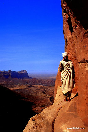 Priest Outside a Rock-Carved Church, Ethiopia