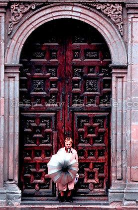 EXT. Old Church Door. Rainy Day... Mexico