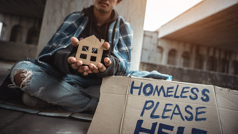 Young homeless boy holding a cardboard h