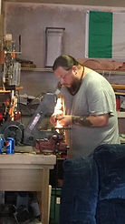 James Collins working at his workbench
