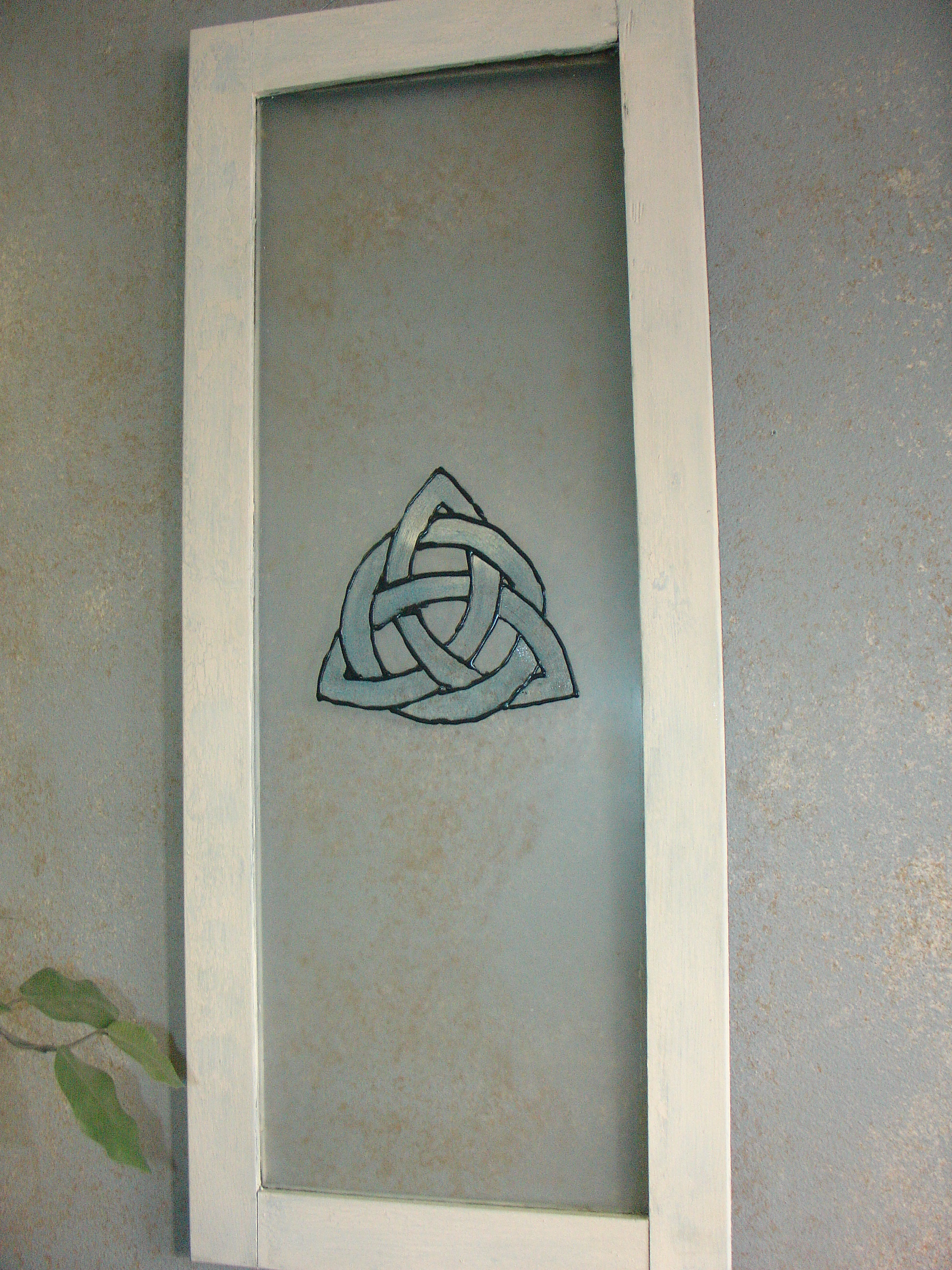 Triquetra on Antique Window