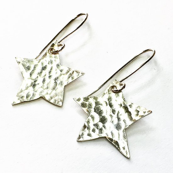 Hammered silver star dangle earrings