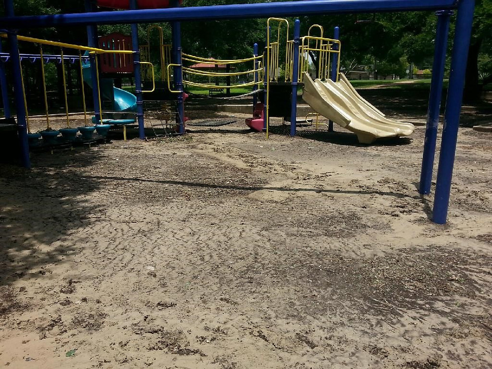 This photo shows that the engineered wood fiber that was placed on the playground earlier this year has been washed away from this playground located nearest the creek. This area was completely flooded.